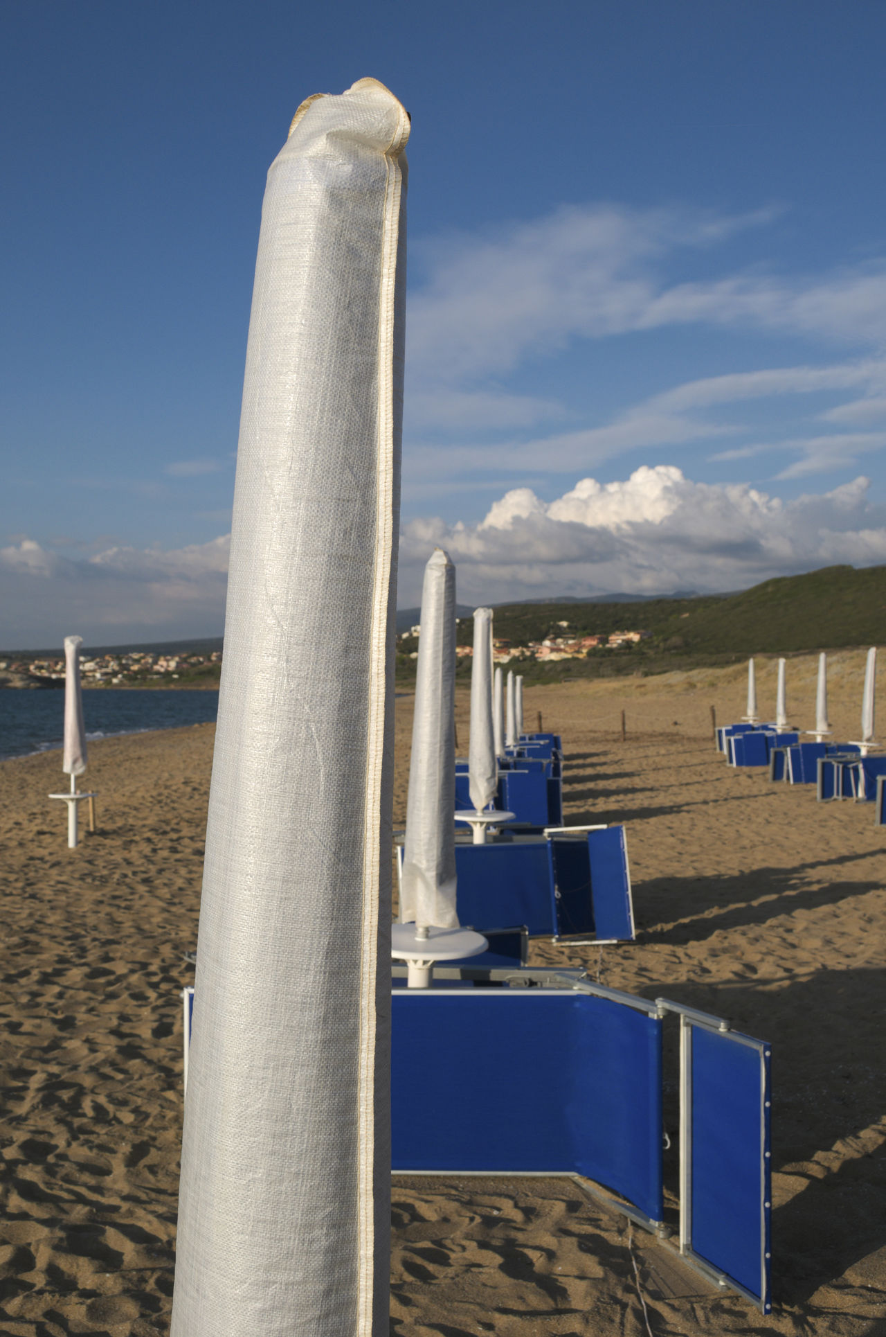 end of season in Is Arenas, Sardinia, Italy Absence Beach Closed Day Deckchairs Deserted End Of Summer Europe Italy Mediterranean  No People Off Season Outdoors Parasol Resort Sardinia Seaside Seasonal Sky Sunbeds Sunlounger Sunshade Sunshades Umbrellas