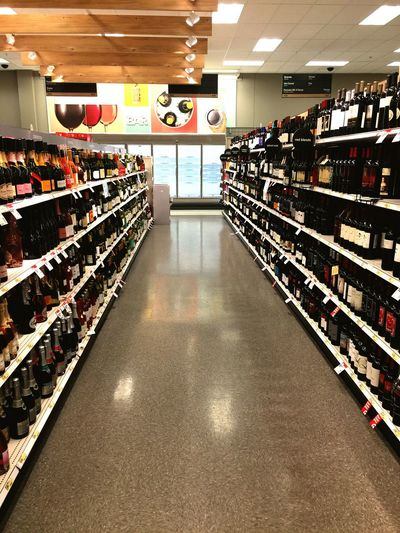 Retail  Shelf Indoors  Store In A Row Consumerism Choice Variation Food And Drink Large Group Of Objects Supermarket Abundance Wine Bottle Bottle Customer  Storage Compartment Food And Drink Industry Drink Wine Cellar Store Decor
