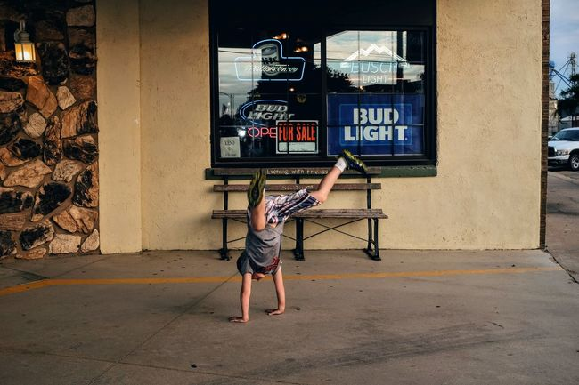 Photo essay, a day in the life. August 24, 2016 Milligan Nebraska 35mm Camera A Day In The Life Athletic Building Exterior Camera Work Cartwheel Check This Out Childhood City Life Everyday Lives Eye For Photography Eye4photography  EyeEm Best Shots EyeEm Gallery Eyeemphoto FujiX100S Full Length Handstand  Kids Being Kids Outdoors Photo Essay Small Town Stories Storytelling Stunts Upside Down
