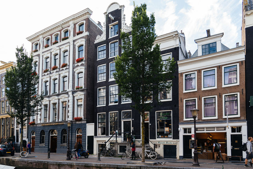 Amsterdam street scene. Red light District in Amsterdam Amsterdam Architecture Bicycle Building Exterior Canal Houses Canals City City Life Cityscape Cityscapes Day Houses No People Outdoors Red Light District S Sky Street Life Tree