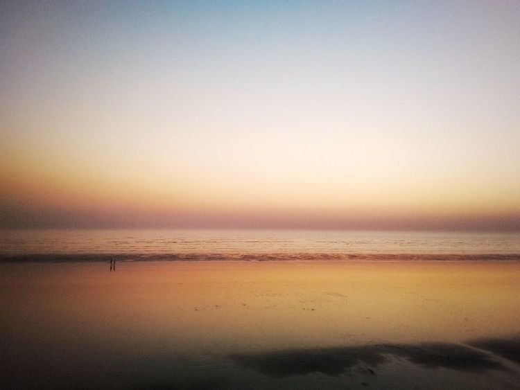 Sunset Water Nature Tranquil Scene Reflection Sky Tranquility Beauty In Nature Sea Scenics Beach Idyllic Outdoors Horizon Over Water Day EyeEmNewHere Sand Togetherness Family Friends Sun People Beauty In Nature Original Experiences Beach Walk