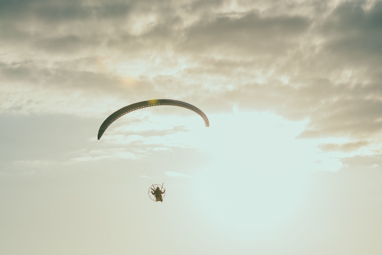 Paraglider Adventure Beauty In Nature Cloud - Sky Day Extreme Sports Flying Freedom Gliding Leisure Activity Low Angle View Mid-air Nature One Person Outdoors Parachute Paraglider Paragliding People Real People Sky Skydiving Sport