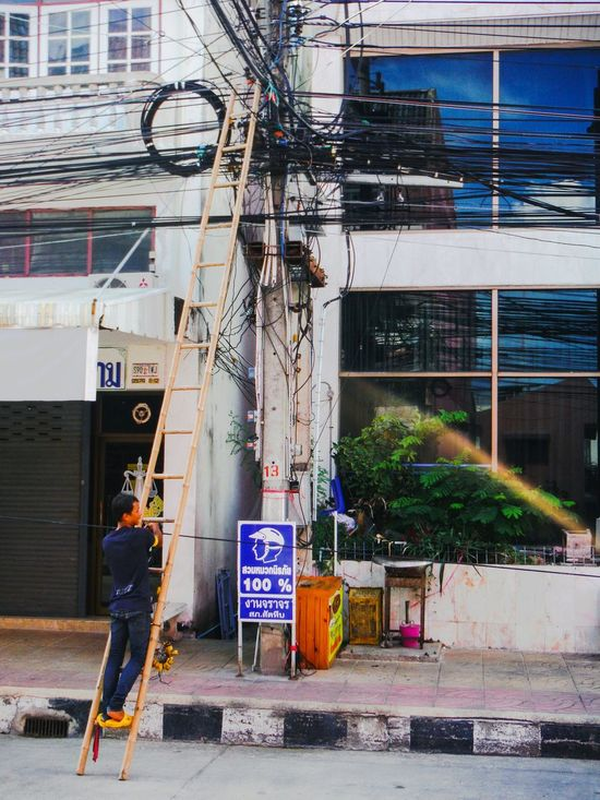 Only in Asia 😁 Everydayasia Asianlife Asianstreets Streetphotography Street Photography Sattahip Thailand Powerlines Power Lines Electric Pole Power Cable Power Supply Power Line  Cable Electric Tower  Electric Tower  Repairman Repair Repair Work Fixing Things Bamboo Ladder Dangerous Dangerous Jobs Dangerous Work Unsafe