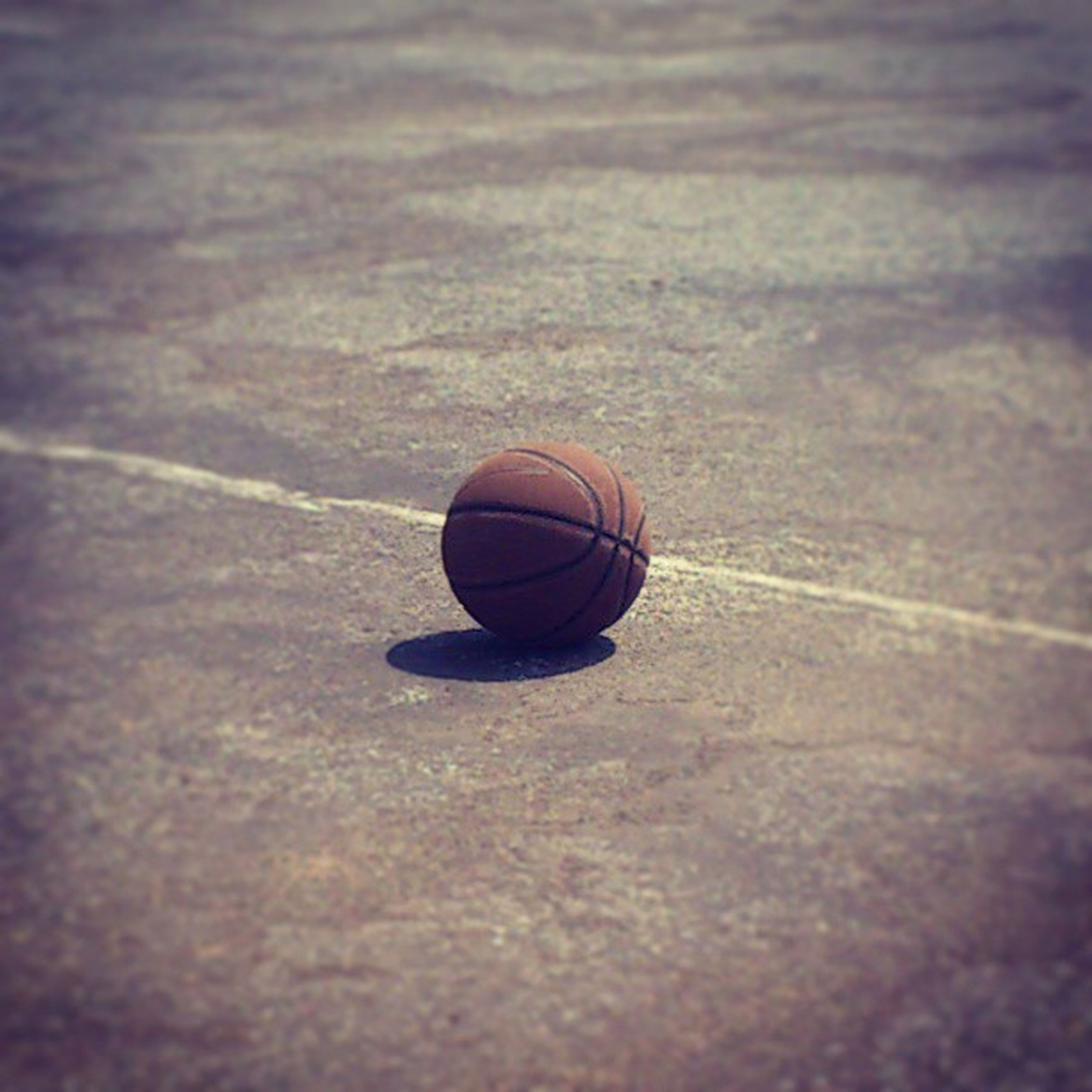 single object, circle, close-up, still life, high angle view, selective focus, no people, indoors, metal, geometric shape, day, shadow, focus on foreground, man made object, sphere, pattern, lighting equipment, textured, sport
