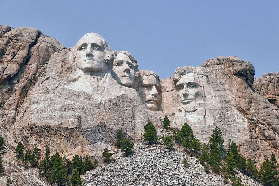 The Mount Rushmore National Memorial in the USA. Clear Sky Mount Rushmore National Memorial Rock South Dakota Trees USA Art And Craft Day Human Representation Low Angle View Nature No People Outdoors Presidents Sculpture