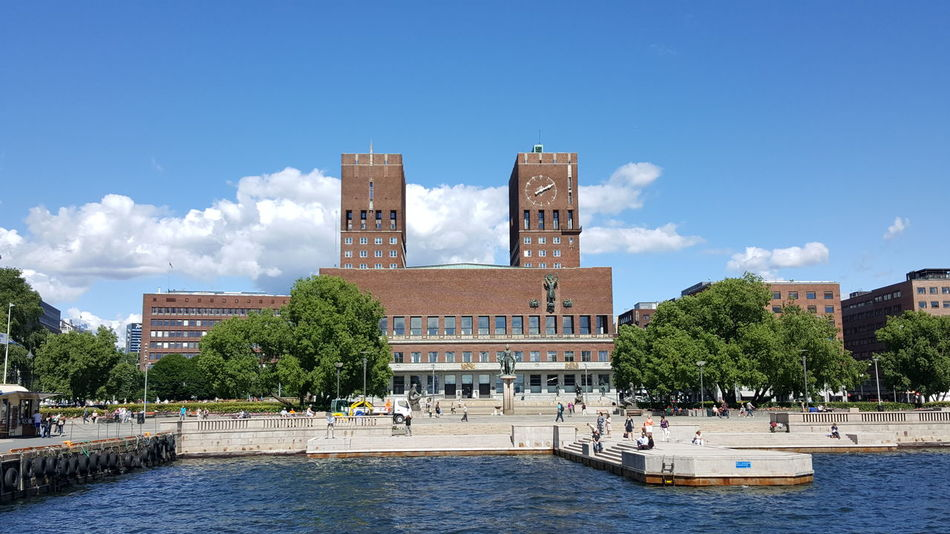 """Oslo City Hall (Norwegian: Oslo rådhus) houses the city council, city administration, and art studios and galleries. The construction started in 1931, but was paused by the outbreak of World War II, before the official inauguration in 1950. Its characteristic architecture, artworks and the Nobel Peace Prize ceremony, held on 10 December, makes it one of Oslo's most famous buildings. It was designed by Arnstein Arneberg and Magnus Poulsson. The roof of the eastern tower has a 49-bell carillon which plays every hour. It is situated in Pipervika in central downtown Oslo. The area was completely renovated and rebuilt to make room for the new city hall, back in the late 1920s. In June 2005 it was named Oslo's """"Structure of the Century"""", with 30.4% of the votes. Architectural Column Architectural Detail Architectural Feature Architecture Architecture Details Architecture Photography Architecture_bw Architecture_collection Architecturelovers Architecturephotography Architectureporn City Hall Eye4photography  EyeEm EyeEm Best Shots EyeEm Gallery EyeEmBestPics From My Point Of View Getting Inspired Hidden Gems  Nobel Peace Prize Politics Rådhus Rådhuset The Purist (no Edit, No Filter)"""