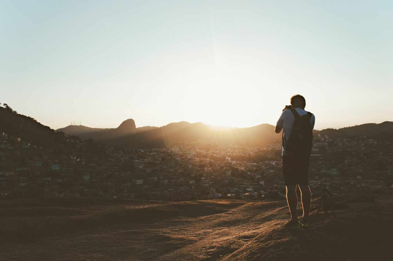 Sunlight Clear Sky Mountain Sunbeam Standing Lifestyles Leisure Activity Sunrise Men Sun City Mountain Range Tranquility Getting Away From It All Lens Flare Scenics Tranquil Scene Nature Beauty In Nature Outdoors Back Lit
