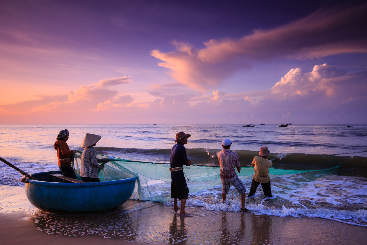 Beach Lagi, Binh Thuan province, Vietnam - August 29, 2015: Unknown Fishermen who pull up th are the fishing nets khi sunrise. This is ask for their daily work Boat Agriculture Farm Beach Beauty In Nature Cloud Cloud - Sky Cloudy Day Fishery  Fishing,diving,speed, Horizon Over Water Idyllic Leisure Activity Lifestyles Nature Outdoors Pulled Pork Scenics Sea Sky Sunset Tannedgirl Tranquil Scene Tranquility Water