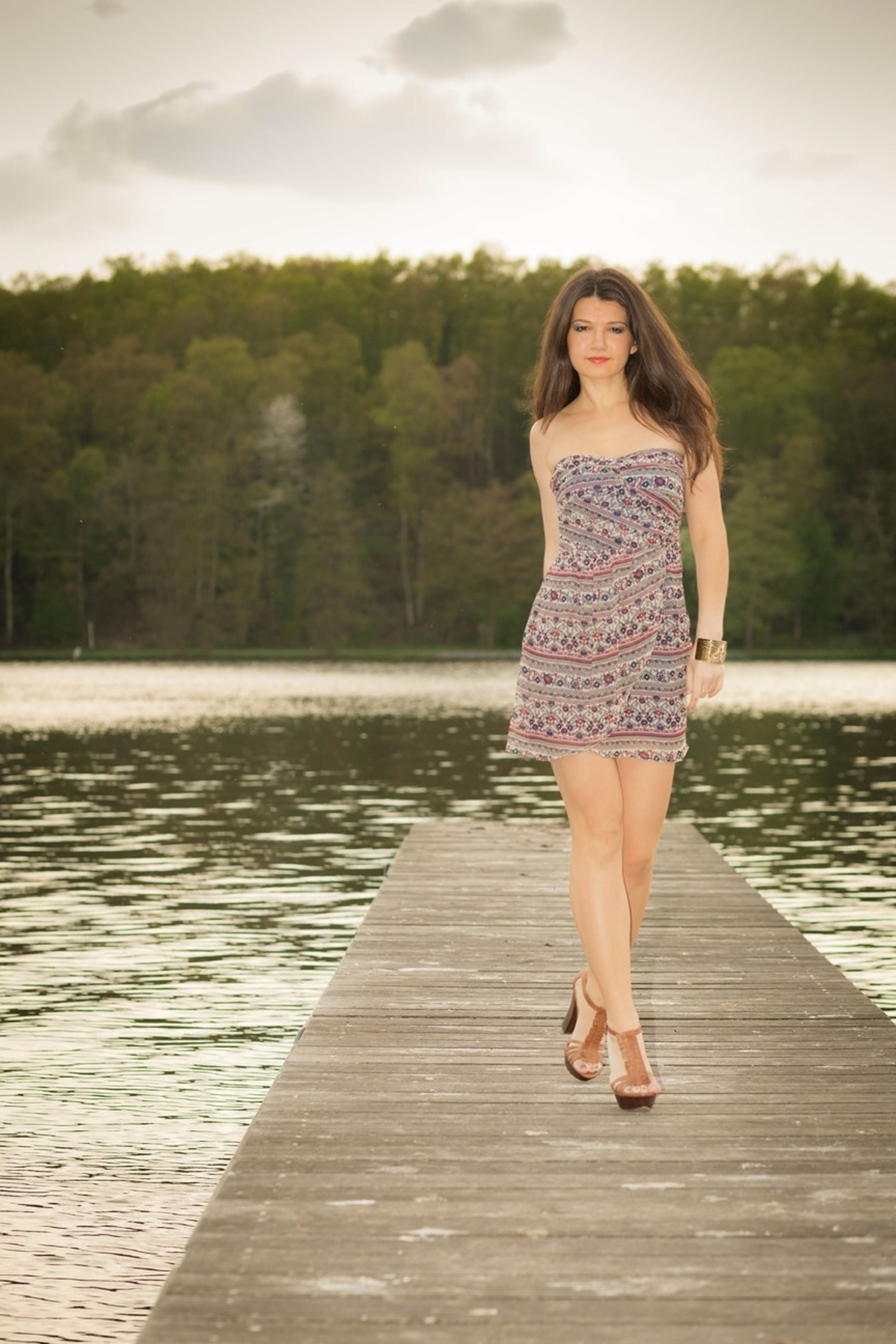 young adult, full length, lifestyles, casual clothing, person, standing, leisure activity, young women, tree, water, sky, front view, outdoors, day, sunlight, portrait, looking at camera