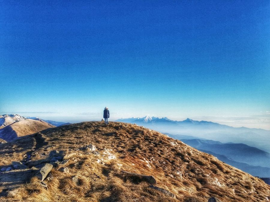 EyeEmNewHere EyeEm Nature Lover EyeEm Gallery Nature Blue Sky One Person Lifestyles Outdoors Beauty In Nature Landscape Mountains Mountains And Sky Italianlandscape Flying High EyeEmNewHere