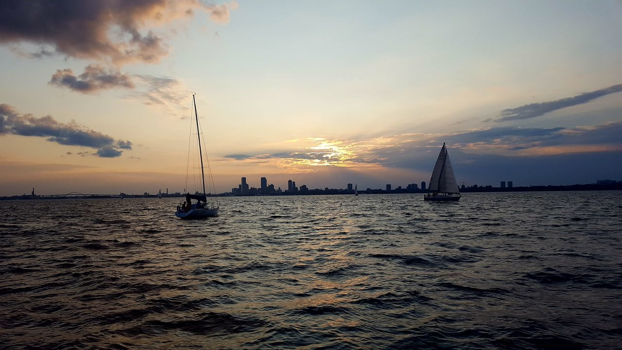Sunset Sky Outdoors Water City Urban Skyline Onaboat On A Boat Sailing Beach Sea Cloud - Sky Silhouette Travel Destinations No People Sand Tranquility Scenics Vacations Cityscape Horizon Over Water Nature Architecture Second Acts