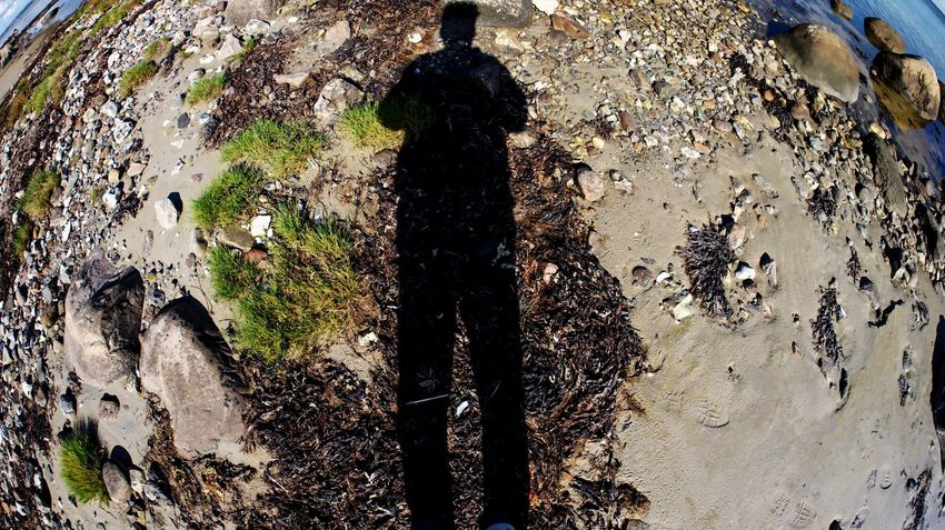 Coastline Fisheye Focus On Shadow High Angle View Leisure Activity Lifestyles One Person Outdoors Real People Shadow Silhouette Sunlight