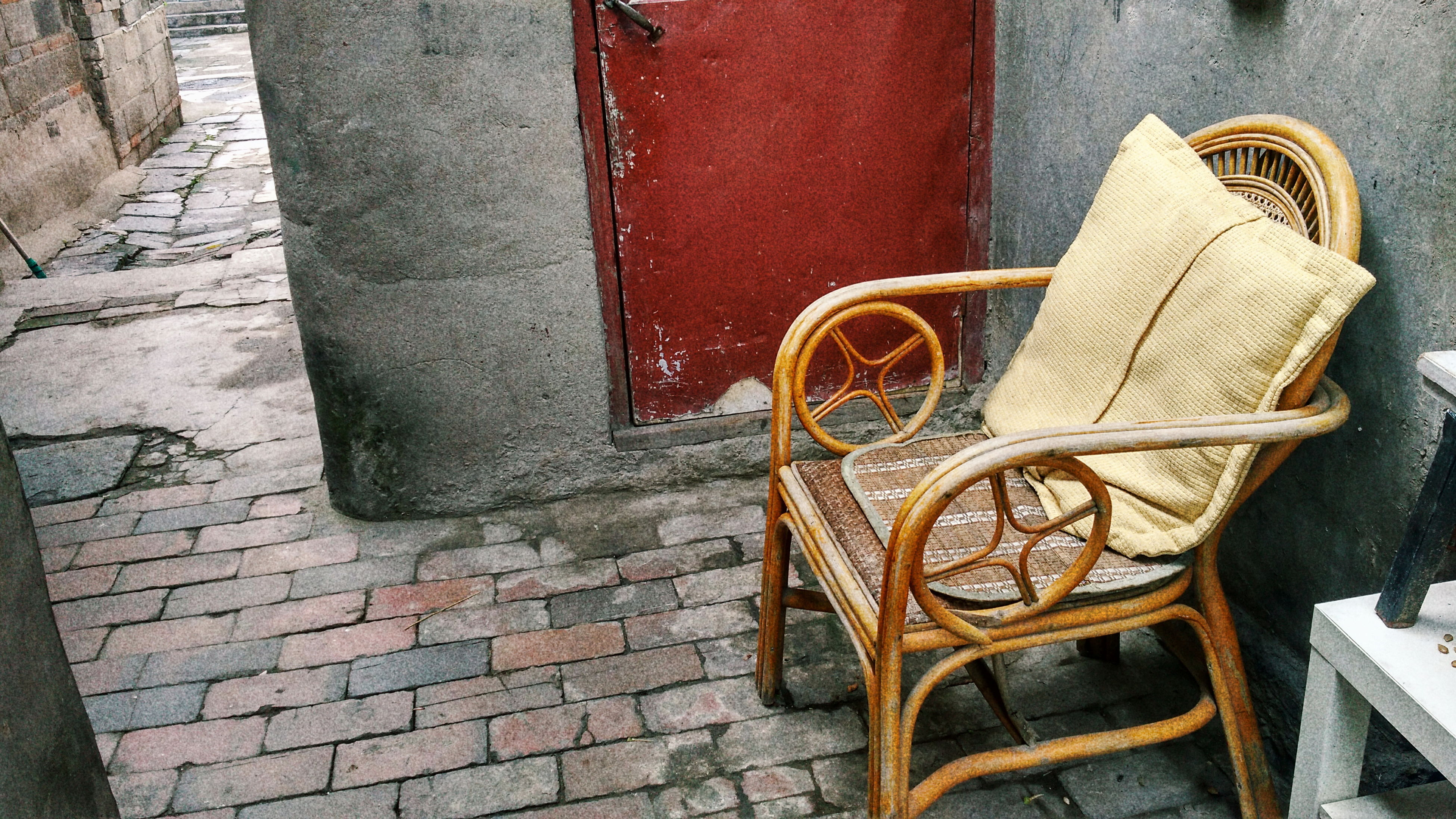chair, absence, abandoned, wall - building feature, empty, old, obsolete, outdoors, the past, day, man made object, no people, weathered