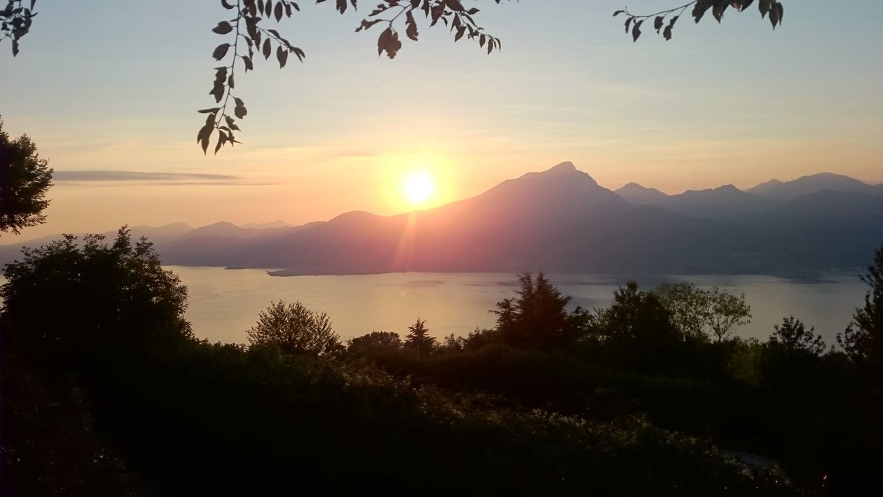 Sanzeno Garda Sunset Water Mountain Beauty In Nature Restaurant Sun Tree Sky Idyllic Sunbeam Majestic Nature Lake Lake View