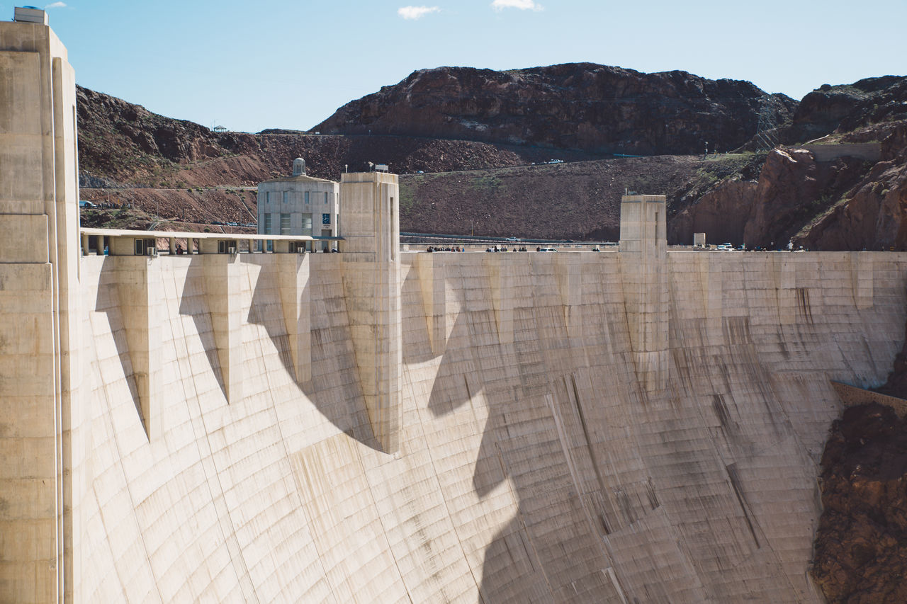 dam, hydroelectric power, mountain, architecture, built structure, day, no people, fuel and power generation, mountain range, sunlight, outdoors, nature, travel destinations, scenics, power station, sky