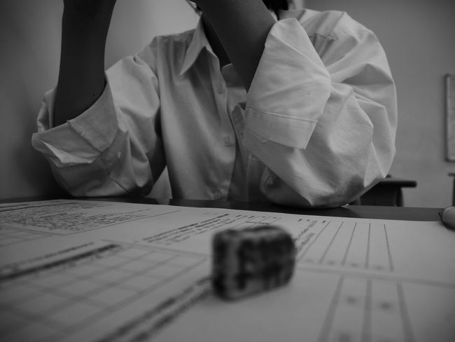 One Person Table Indoors  Paper Person Real People Close-up Human Body Part Writing Instrument Low Section Day Highschool Autumn Myfriend Girl High School Afternoon Afterschool  Japan Tokyo Camera Lumix Japan Photography Monochrome Photography