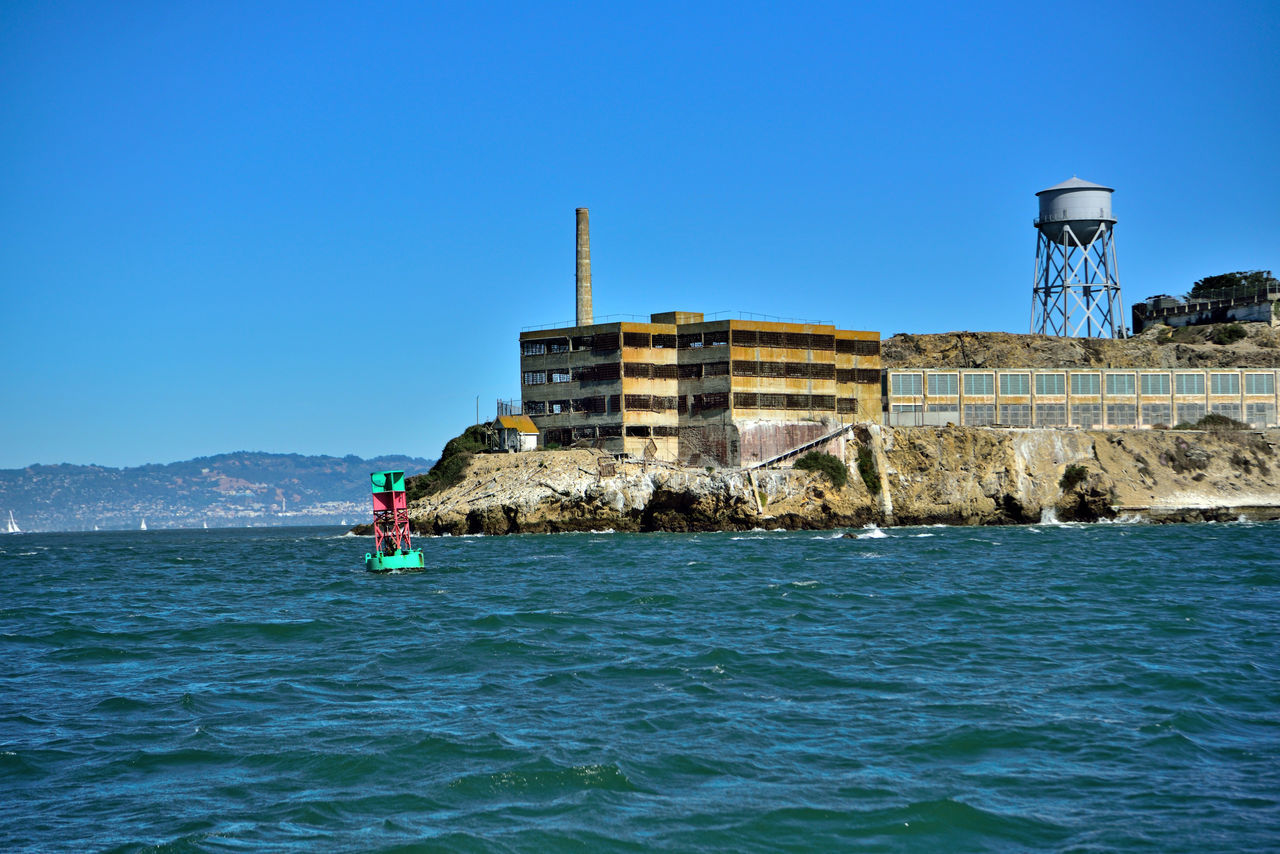 Alcatraz Island From The Almas Bow 3 Flat-bottomed Wooden-hulled Scow Schooner Cargo Ship Built 1891 Sailing San Francisco Bay Abord The Alma Federal Penitentiary 1934-63 1st A U.S.Army Military Prison The Rock Site Of A Citadel 1860 Prison Building Built 1912 Maximum High-security Prison Warden's House Today Managed By The National Park Service Water Tower Now A Museum Showing Tours Golden Gate National Recreation Area Landscape_Collection Landscape_photography Alcatraz Island Eastbay Hills Buoy