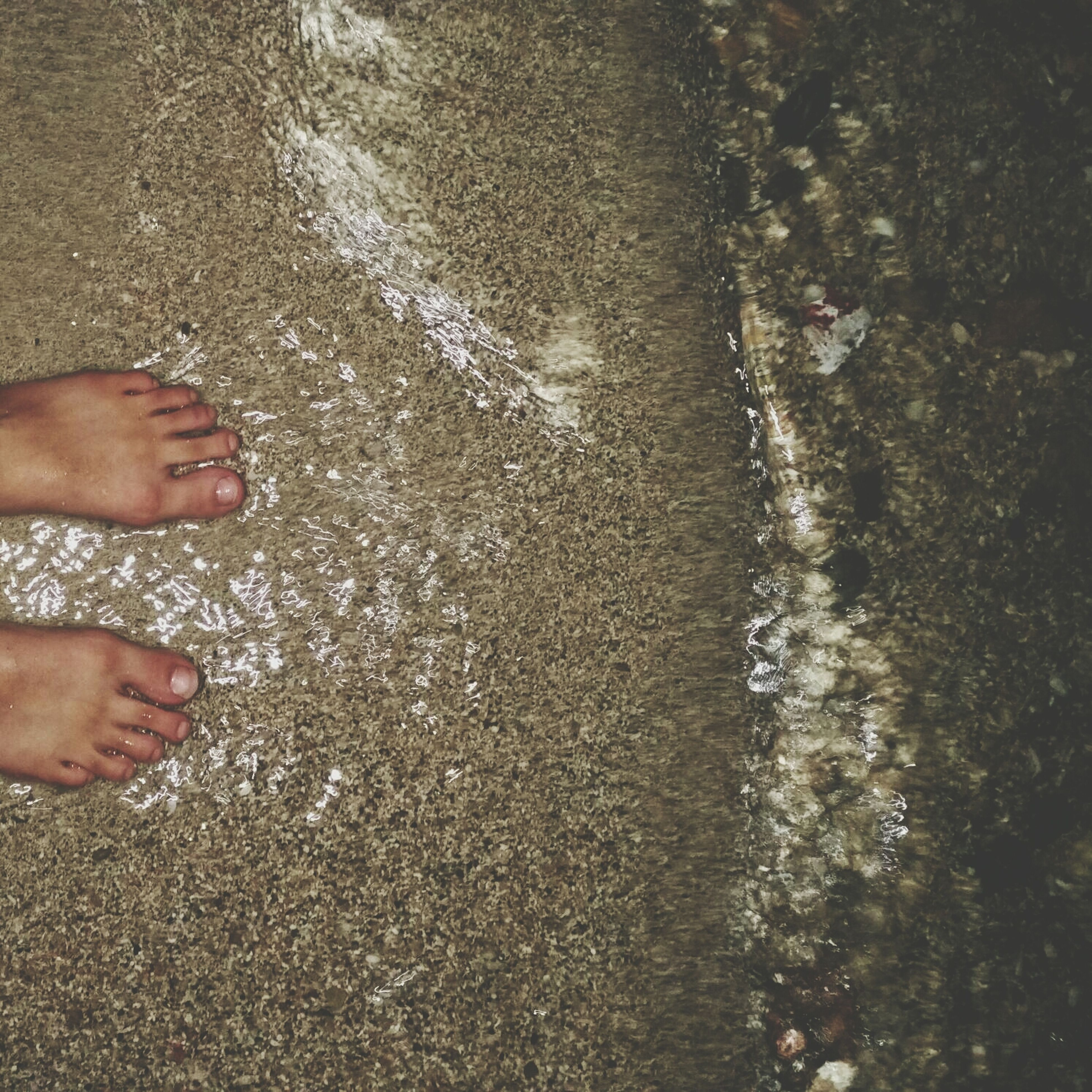 water, lifestyles, low section, person, leisure activity, high angle view, beach, human foot, barefoot, personal perspective, standing, part of, unrecognizable person, wet, men, shore