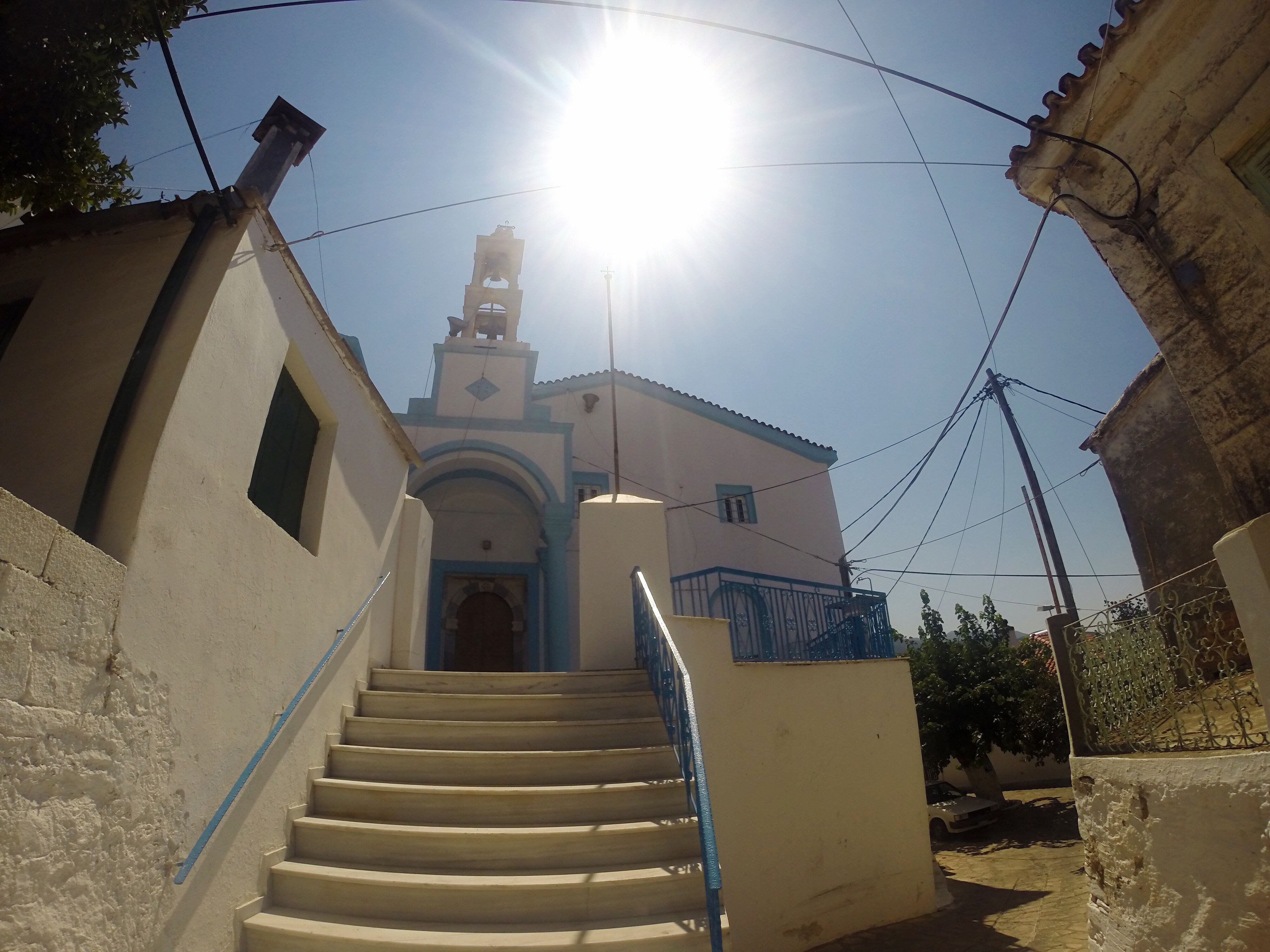 architecture, religion, church, built structure, building exterior, spirituality, place of worship, sun, low angle view, sunlight, steps, sunny, sunbeam, sky, clear sky, blue, outdoors, day, lens flare, facade, chapel, footpath, no people