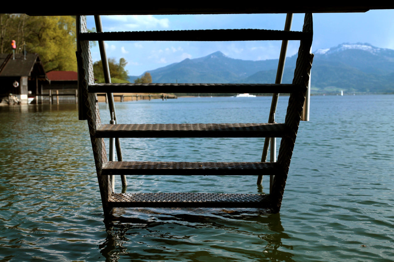 Day Out Descending Jetty Lake Lakeshore Mountain Mountain View Mountains No People Non-urban Scene Stairs Sunny Day Swimming Tranquility Water Alps Mountain Lake Somehow the water doesn't look as cold as it felt.