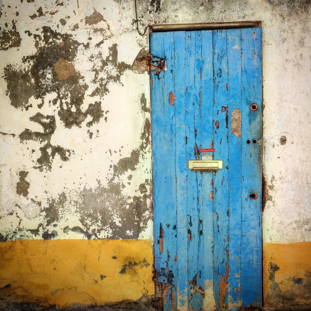 door, closed, day, outdoors, no people, weathered, close-up, yellow, blue, built structure, architecture
