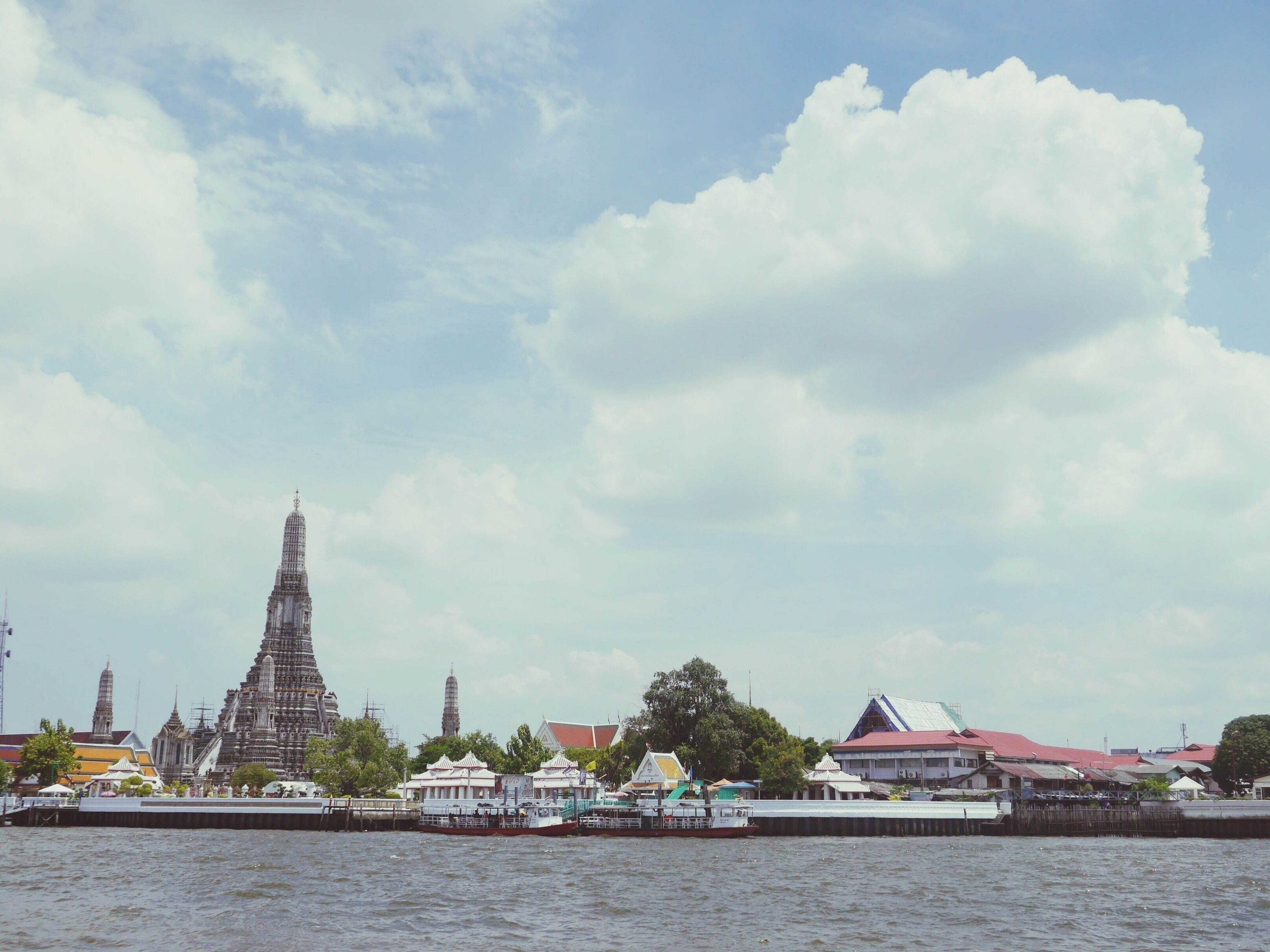 architecture, water, building exterior, built structure, waterfront, sky, cloud - sky, river, nautical vessel, cloudy, cloud, tree, transportation, city, day, mode of transport, canal, boat, outdoors, lake