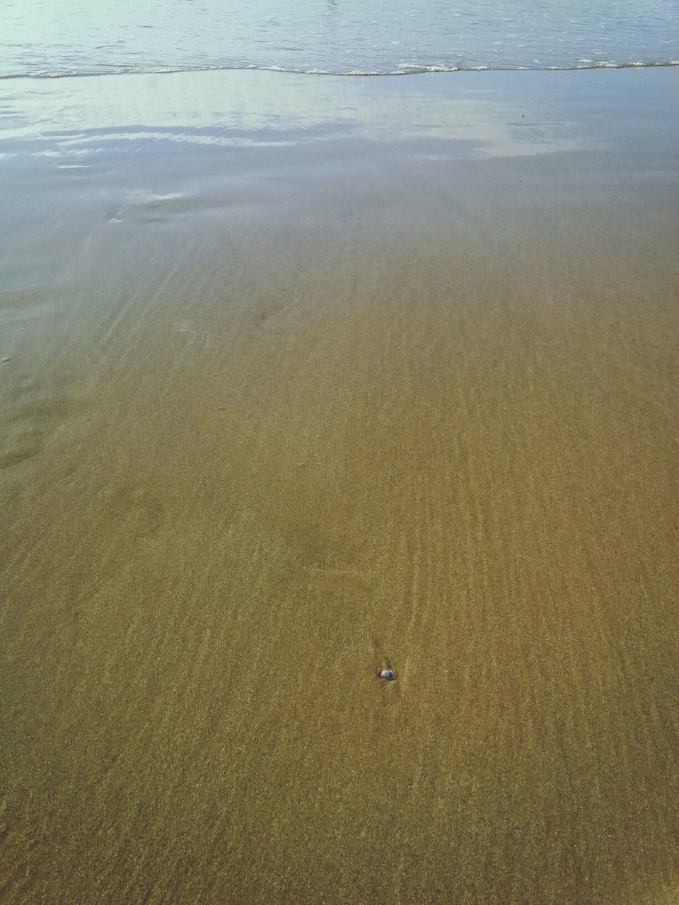 High Angle View Of Wet Sand At Beach