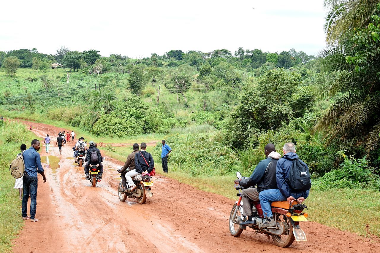 Tree Motorcycle Transportation Day Real People Men Women Outdoors Riding Adult Land Vehicle Headwear People Nature Adults Only Sky Biker Mpara Uganda Let's Go. Together.