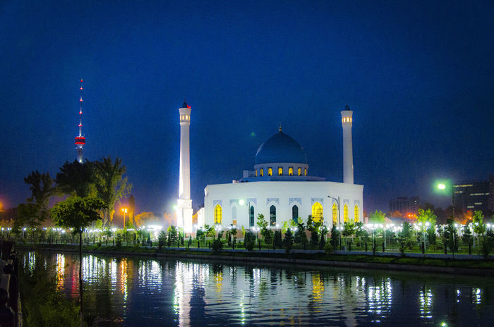 """© Nurmukhammad Abdukarimov • """"Minor"""" Mosque Architecture Blue Built Structure Capital Cities  City Culture Illuminated Lighthouse Minor Minor Mosque Mosque Night No People Outdoors Reflection River Sky Tall Tall - High Tashkent Tourism Tower Travel Destinations Water White Mosque EyeEmNewHere The Week On EyeEm"""