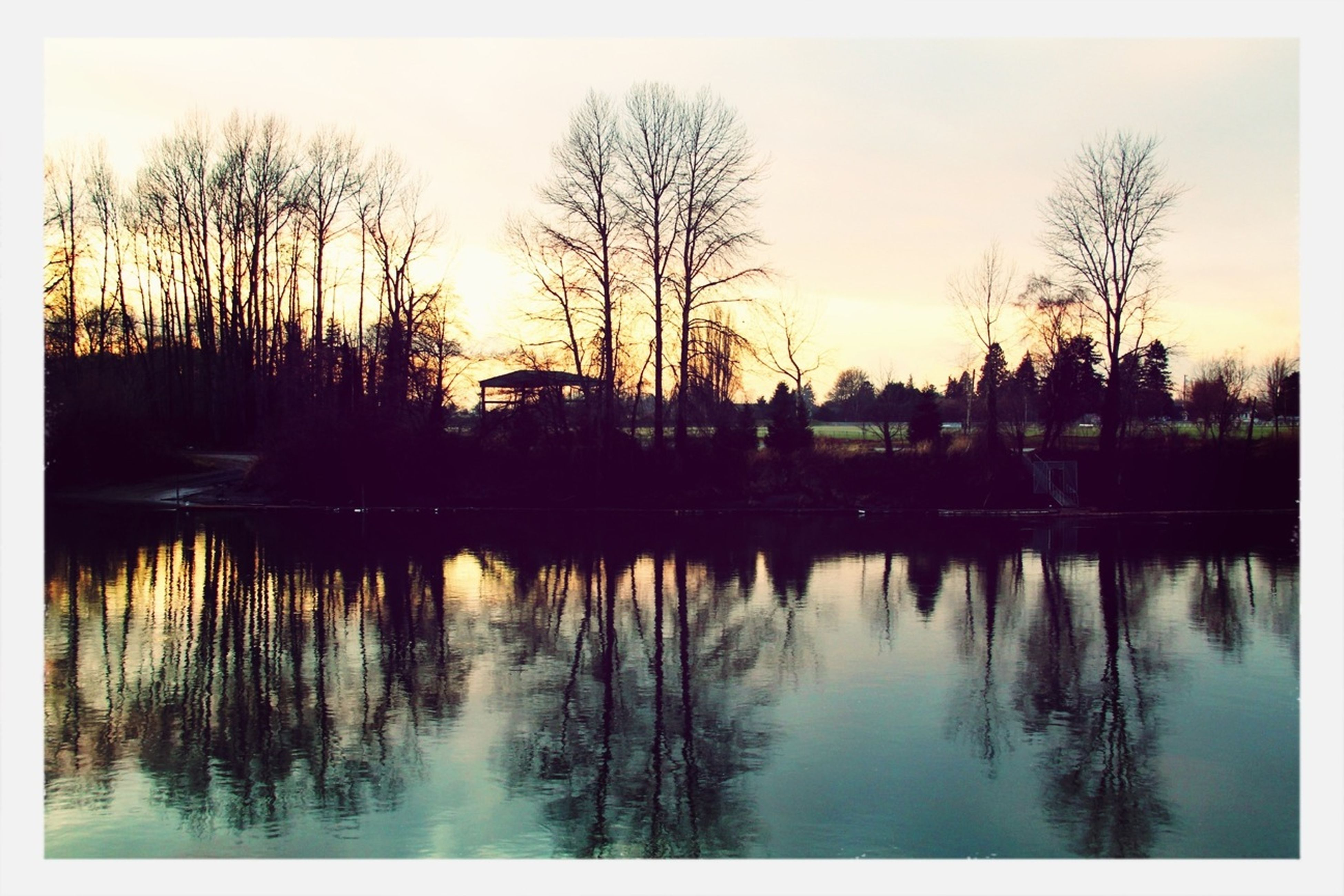 reflection, water, lake, silhouette, sunset, tree, transfer print, waterfront, bare tree, tranquility, tranquil scene, sky, scenics, clear sky, auto post production filter, beauty in nature, nature, river, built structure, architecture
