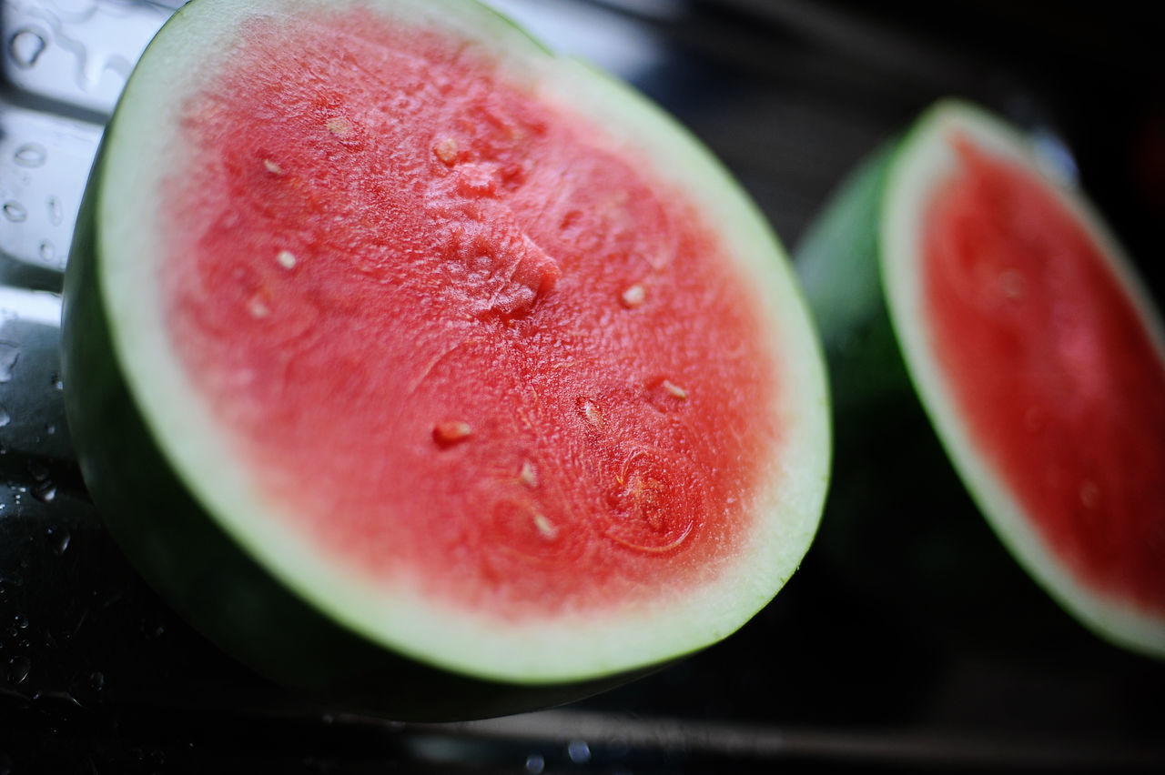 High Angle Close-Up Of Watermelon On Wet Kitchen Counter