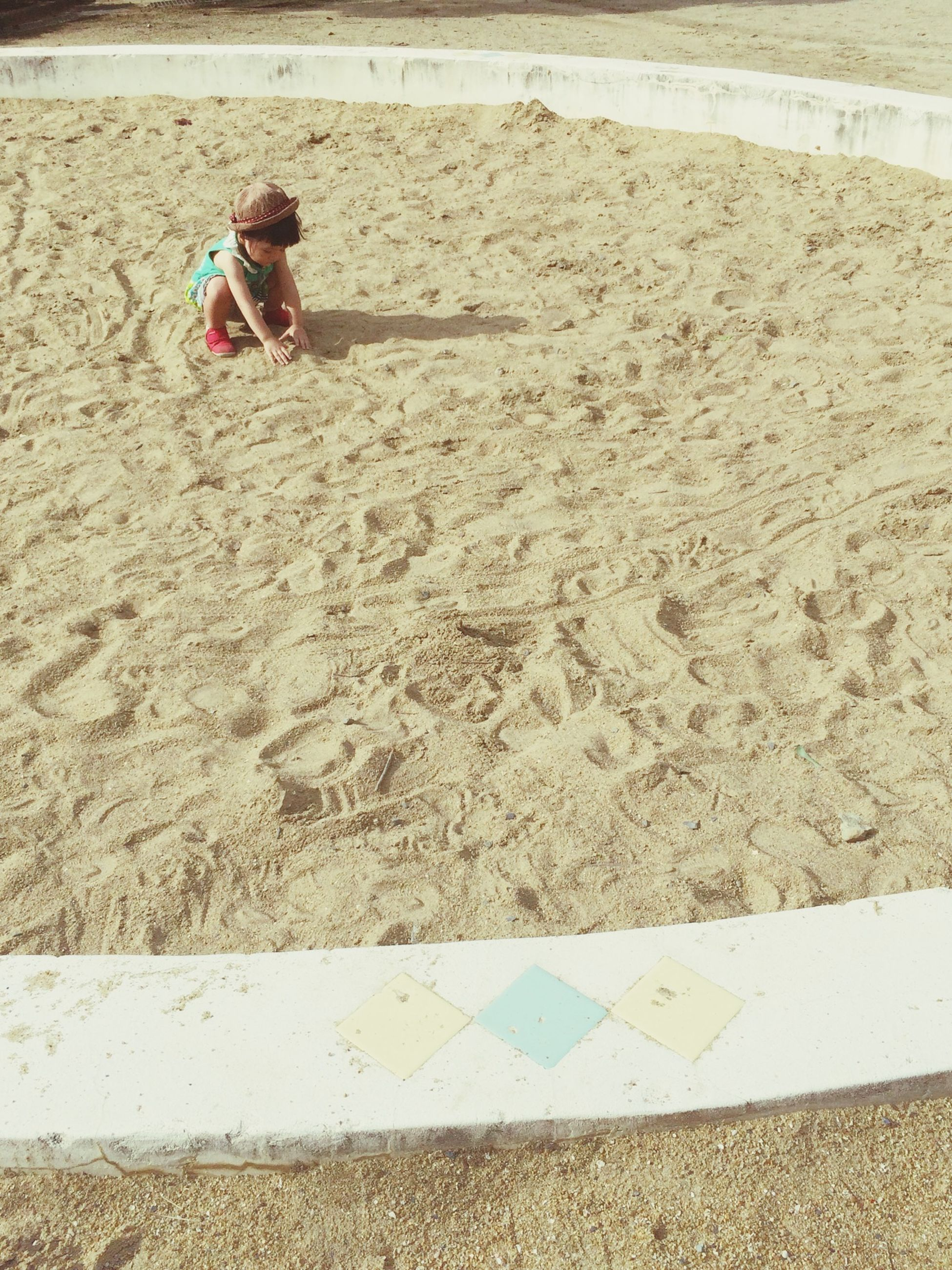 sand, lifestyles, leisure activity, full length, beach, casual clothing, childhood, sunlight, high angle view, day, street, shadow, outdoors, boys, shore, walking, men, road