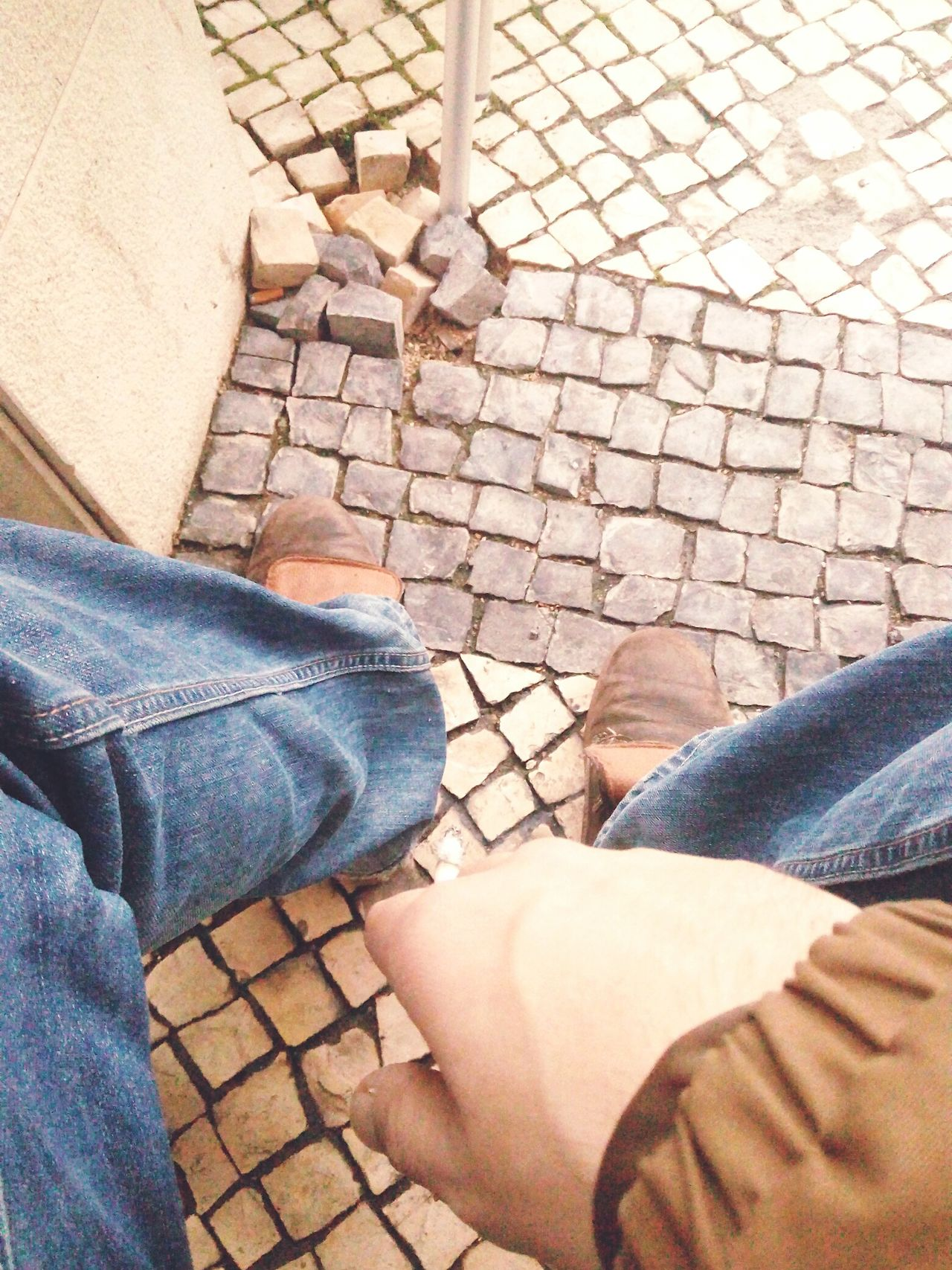 Cigarette Time Addiction Low Section Human Leg Real People Jeans One Person Lifestyles Sunlight Personal Perspective Standing Shoe Day Women Human Body Part Outdoors Close-up Adult People