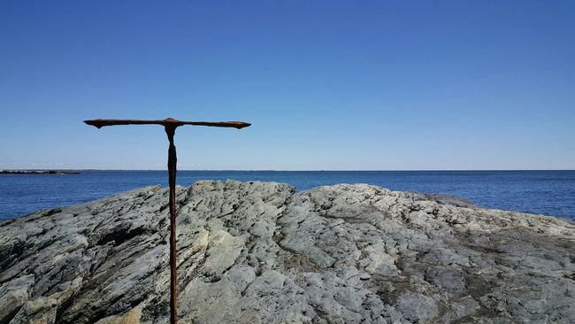 Rus-T. By The Sea Ocean Tranquil Scene Tranquility Blue Scenics Beauty In Nature Outdoors Symbol Nature Coastline Sea Non-urban Scene Day Vacations Sunshade Rock Rusted Metal  Cliff Walk Cliffview EyeEm Gallery Eyeemphotography EyeEm Newport, RI Rhode Island Photography⚓