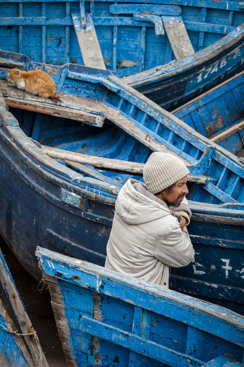 Blue Boats Cat Colors Fisherman Fishing Boats Man Morocco Single Person Tranquility Travel Destinations Work WorkLife Snap A Stranger