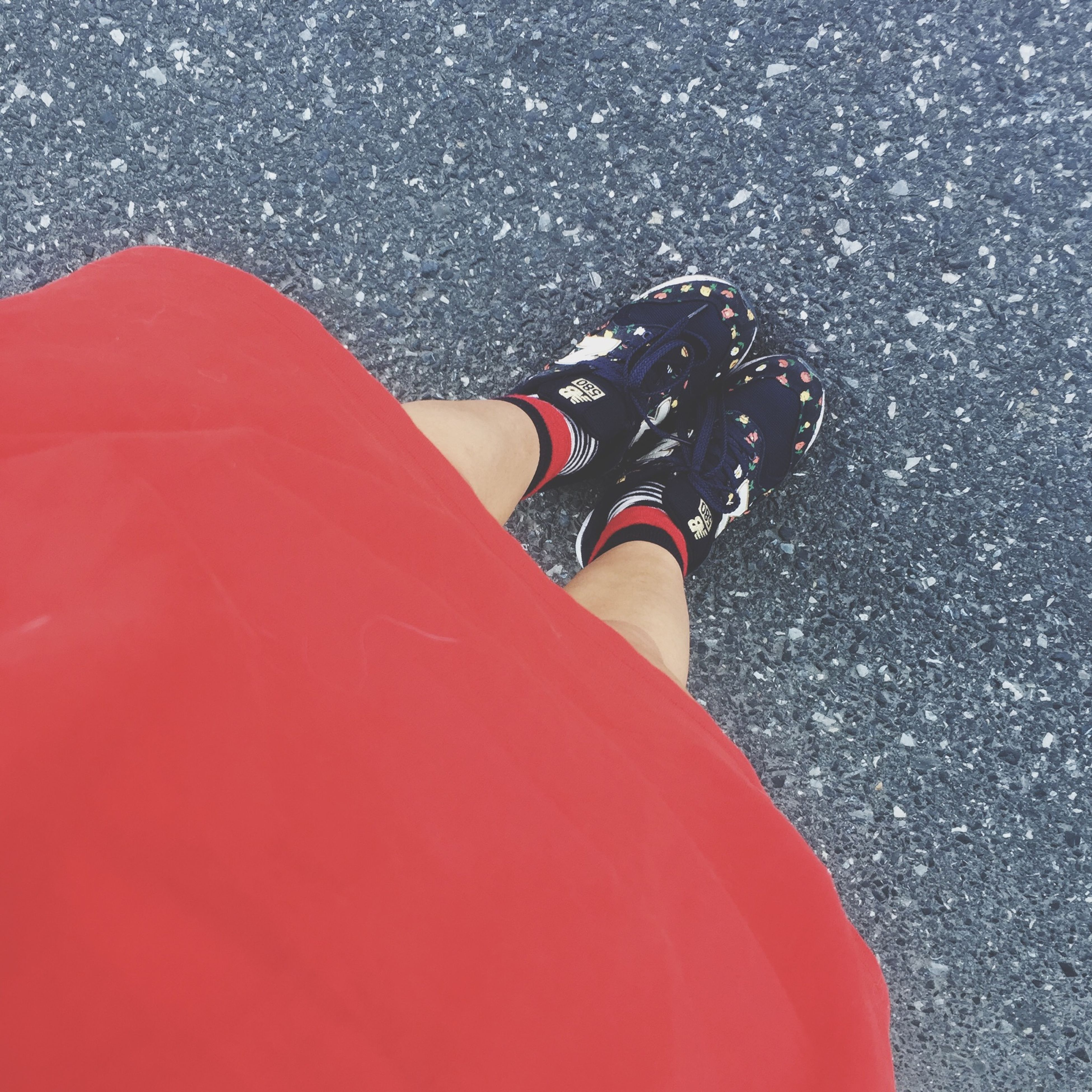 low section, person, lifestyles, high angle view, leisure activity, personal perspective, shoe, standing, street, human foot, red, road, footwear, outdoors, asphalt, day