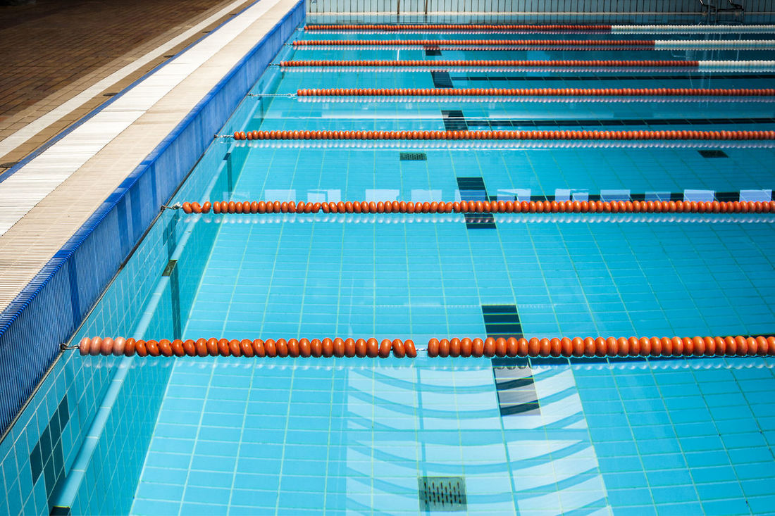 swimming pool 23 blue blue color blue water buoys diminishing perspective large group of objects line