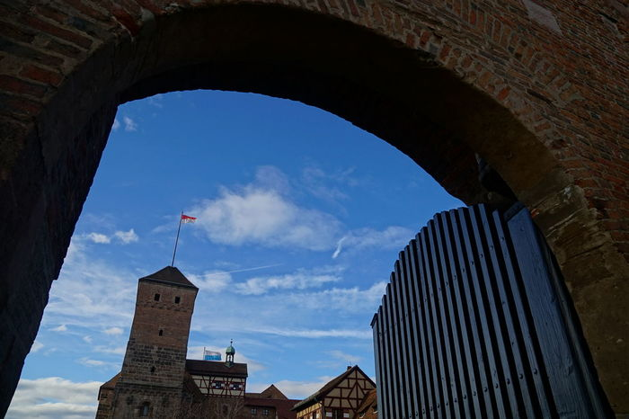 Nuremberg Imperial Castle Chapel Entrance Entrance Gate Gate Nuremberg Nuremberg Old Town Winter Arch Architecture Blue Sky And Clouds Building Exterior Built Structure Castle Gate City Cloud - Sky Day Door Flag Half-timbered Houses Imperial Castle No People Outdoors Sky Tower Travel Destinations