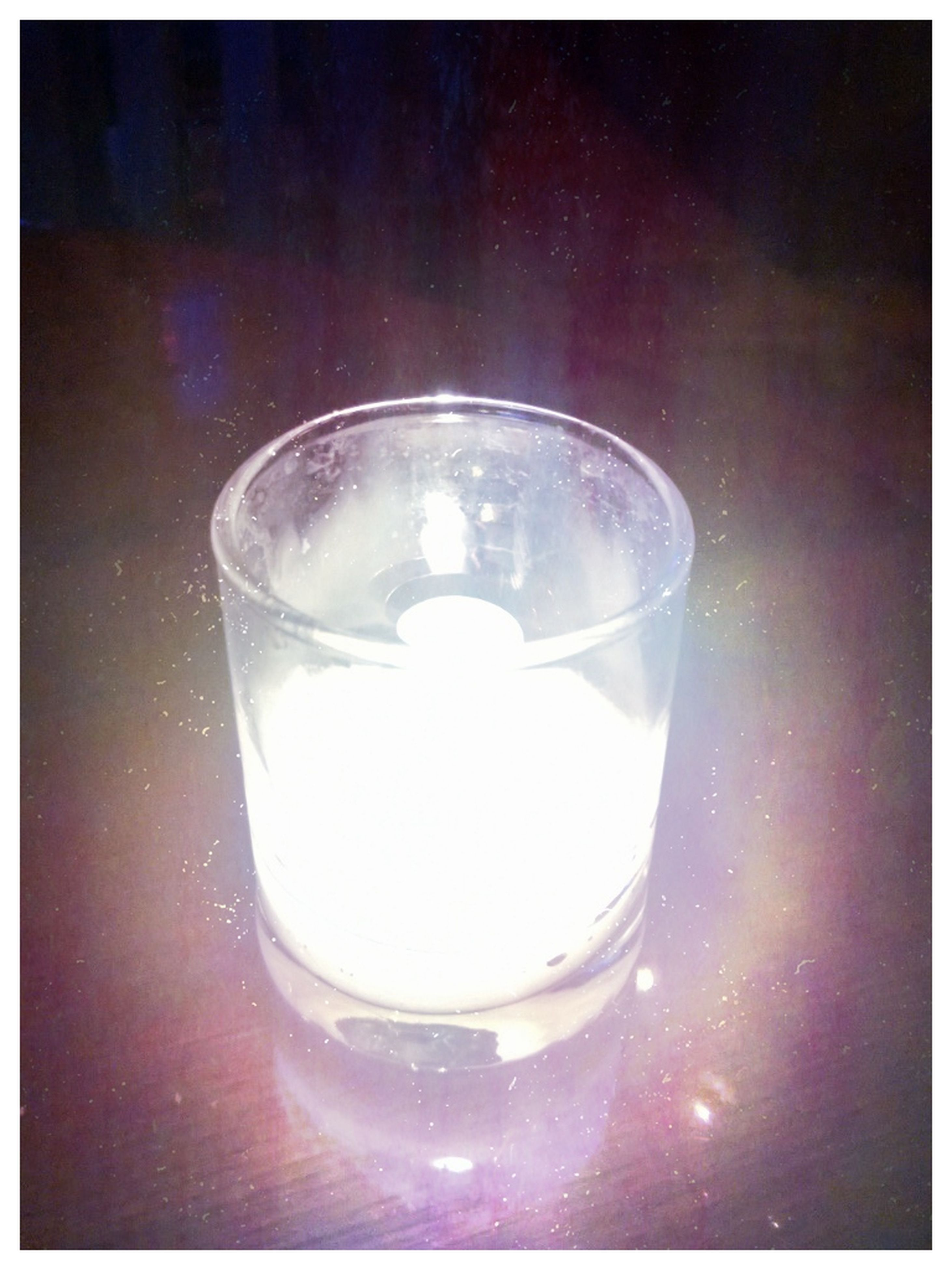 indoors, transfer print, glass - material, transparent, auto post production filter, illuminated, lighting equipment, close-up, light bulb, drinking glass, drink, glass, electricity, glowing, still life, reflection, refreshment, electric light, no people, table