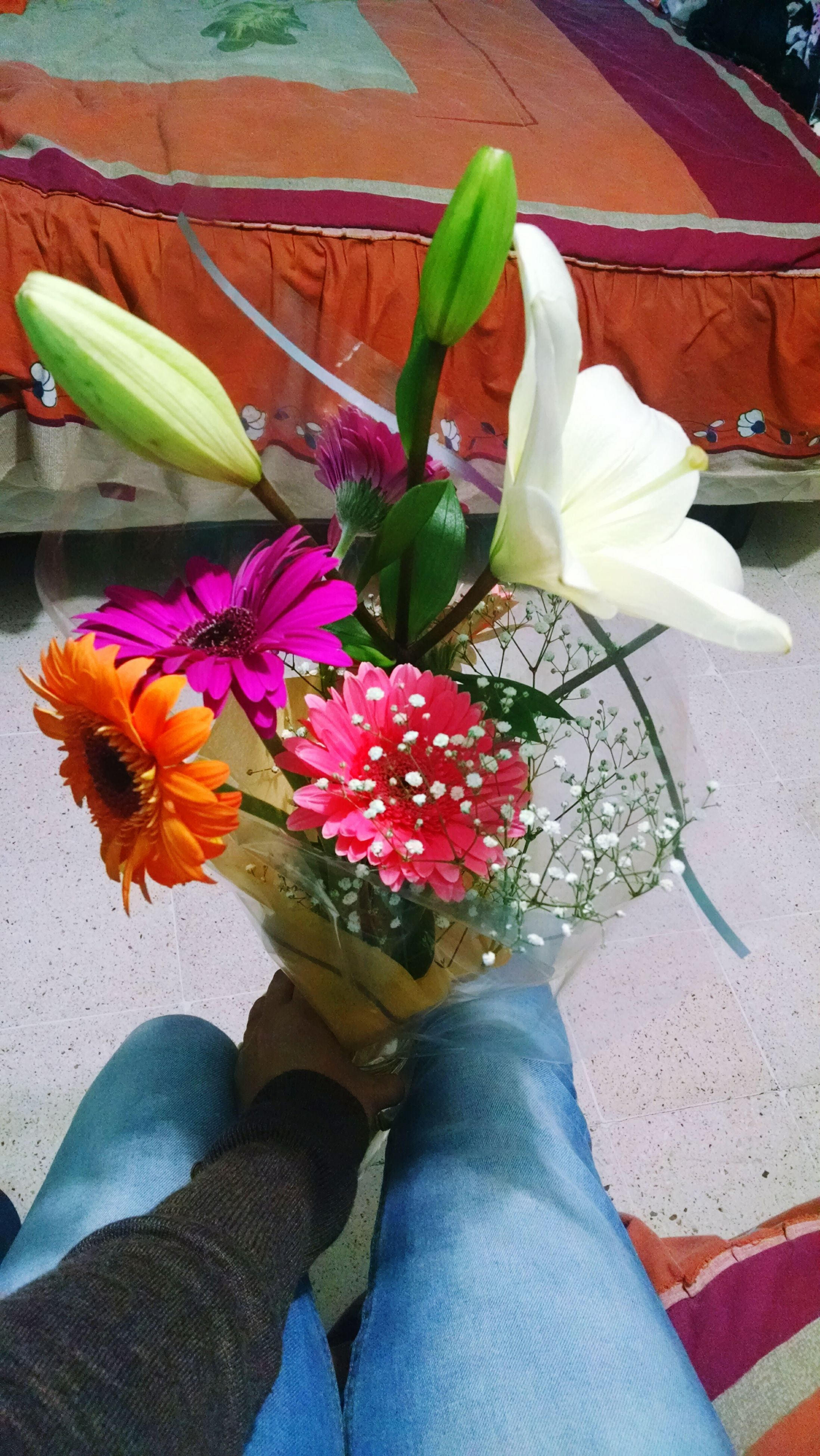 flower, freshness, petal, fragility, high angle view, leaf, flower head, personal perspective, indoors, potted plant, plant, bouquet, red, vase, table, low section, close-up, person