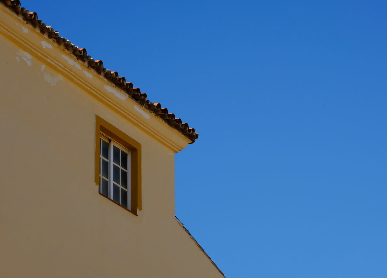 Architectural Detail Blue Building Exterior Clear Blue Sky Clear Sky Complementary Colors Copy Space Copy Space In Sky Flaking Paint High Contrast High Resolution House Lines Low Angle View Minimalism No People Roof Slanted Spain, Andalucia, Malaga Torremolinos Window Yellow Yellow House