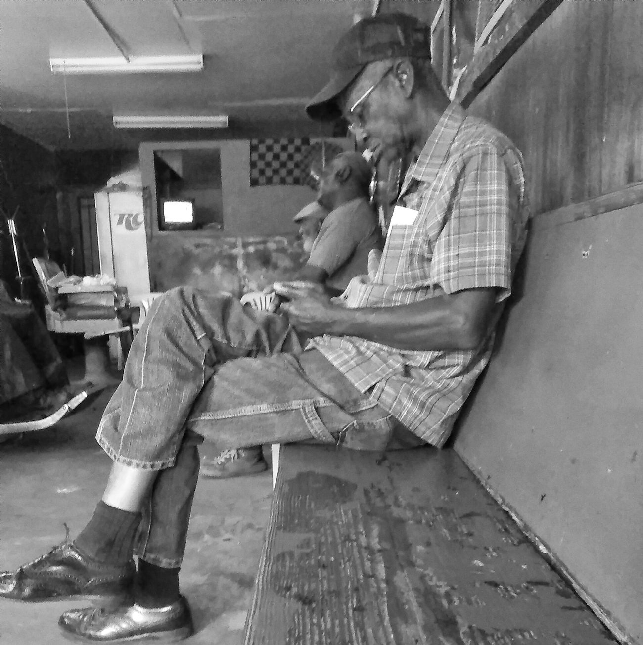 Waiting at the Barbershop! Hanging Out Taking Photos Enjoying Life Street Photography Street Portrait Shoottolive Candid Photography Streetphoto_bw Barbershop Black And White Photography Mobilephotography Androidography Man Lifephotography