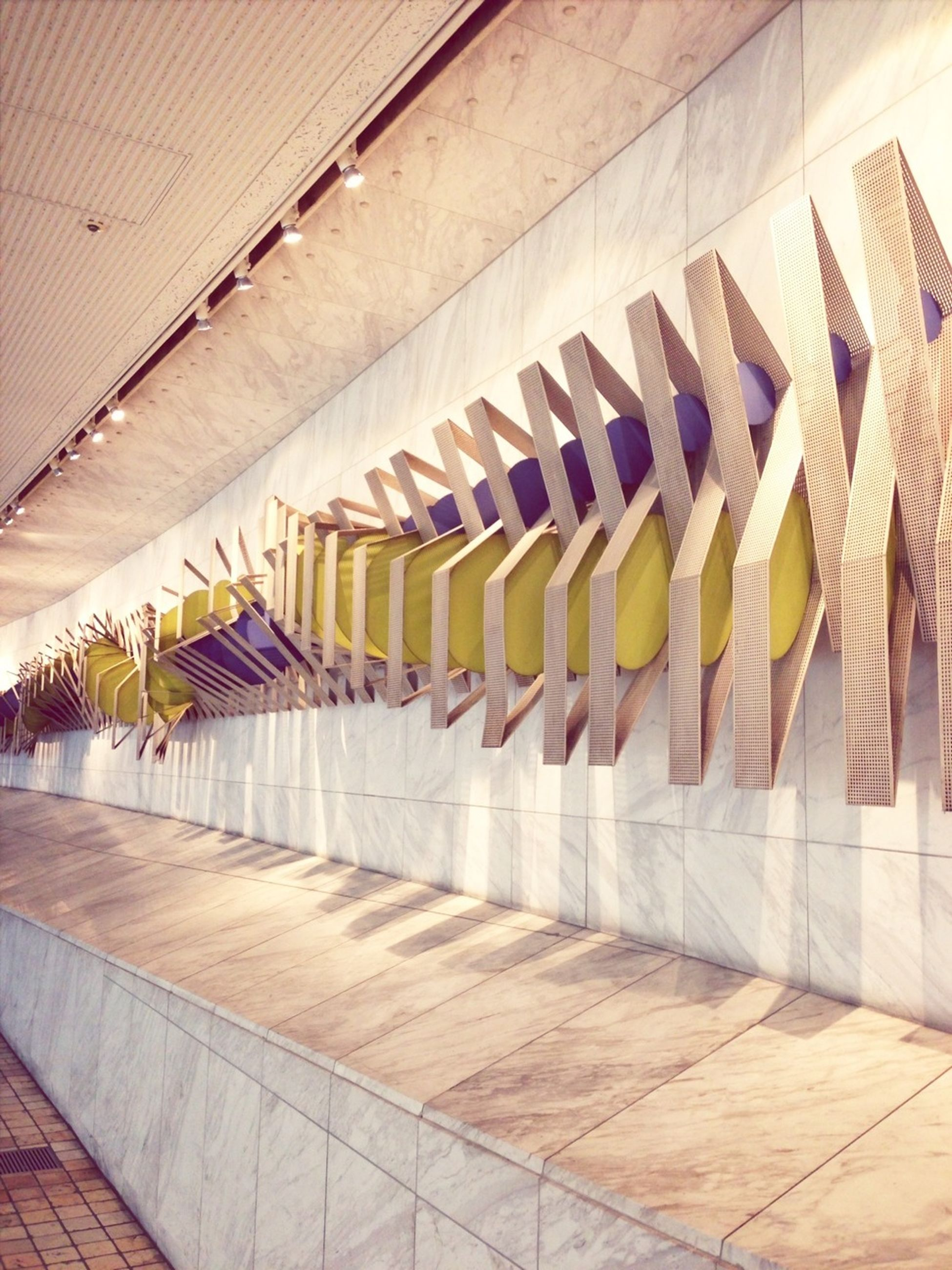architecture, built structure, building exterior, indoors, in a row, repetition, pattern, sunlight, yellow, low angle view, wall - building feature, side by side, building, no people, shadow, modern, arrangement, order, day, window