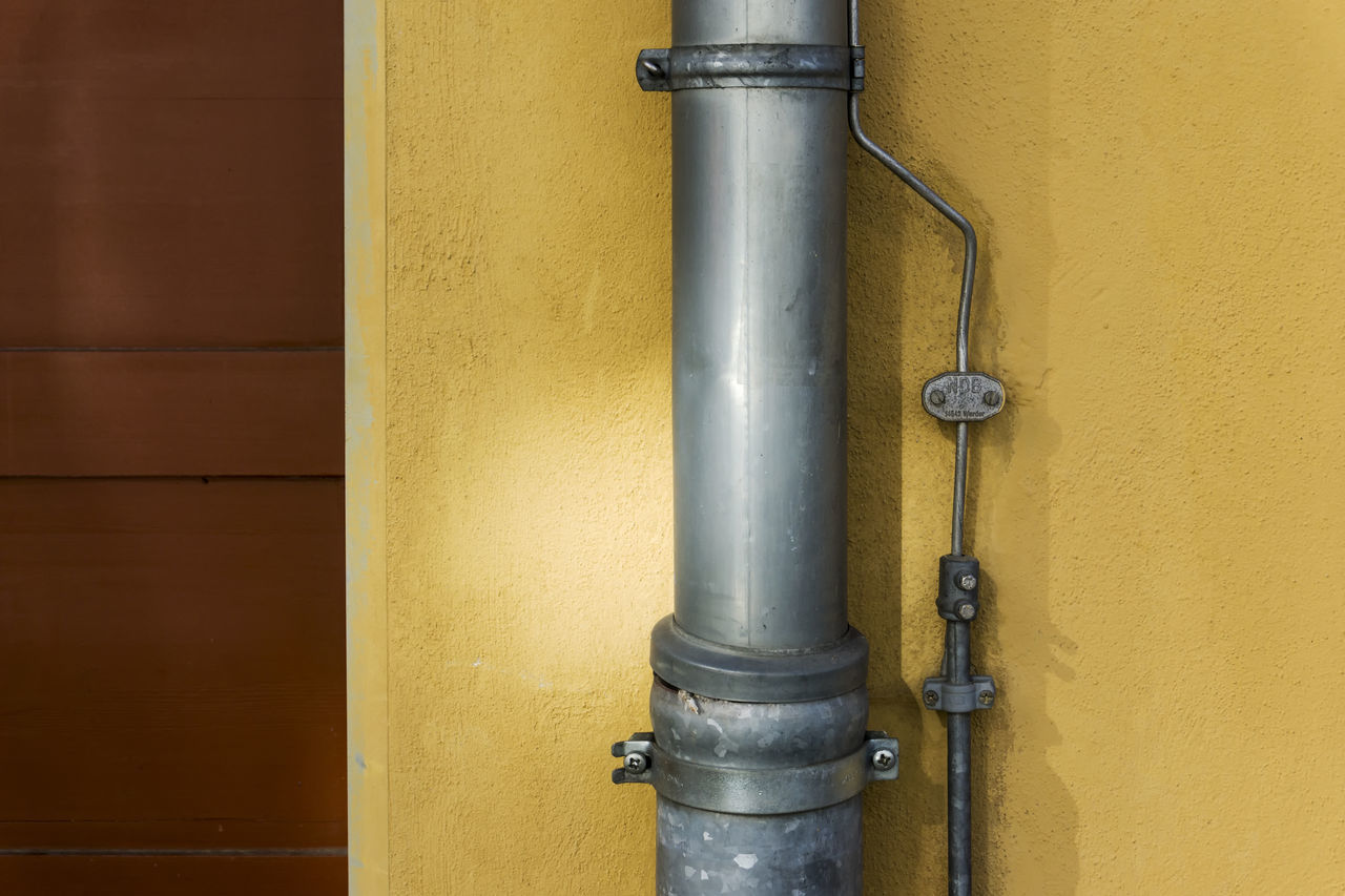 yellow, pipe - tube, pipeline, built structure, metal, no people, pipe, close-up, door, day, architecture, valve, building exterior, water pipe, outdoors, industry