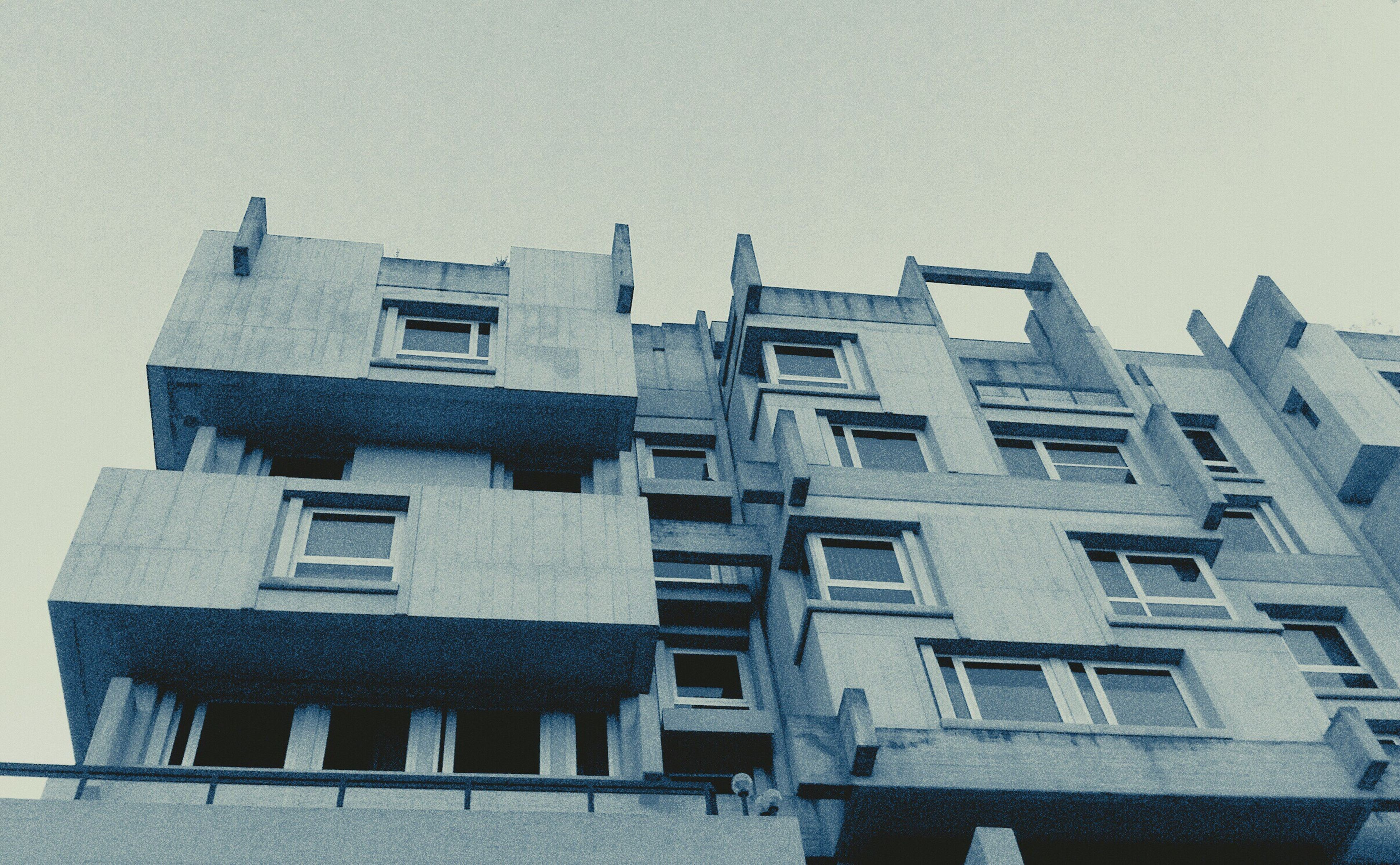 architecture, building exterior, built structure, window, no people, low angle view, outdoors, day, clear sky, city, sky
