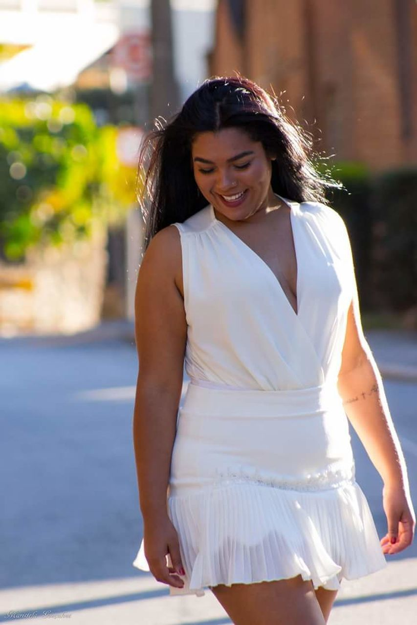 real people, young adult, young women, smiling, one person, happiness, beautiful woman, white color, wedding dress, focus on foreground, outdoors, lifestyles, leisure activity, bride, cheerful, looking at camera, day, standing, full length, portrait