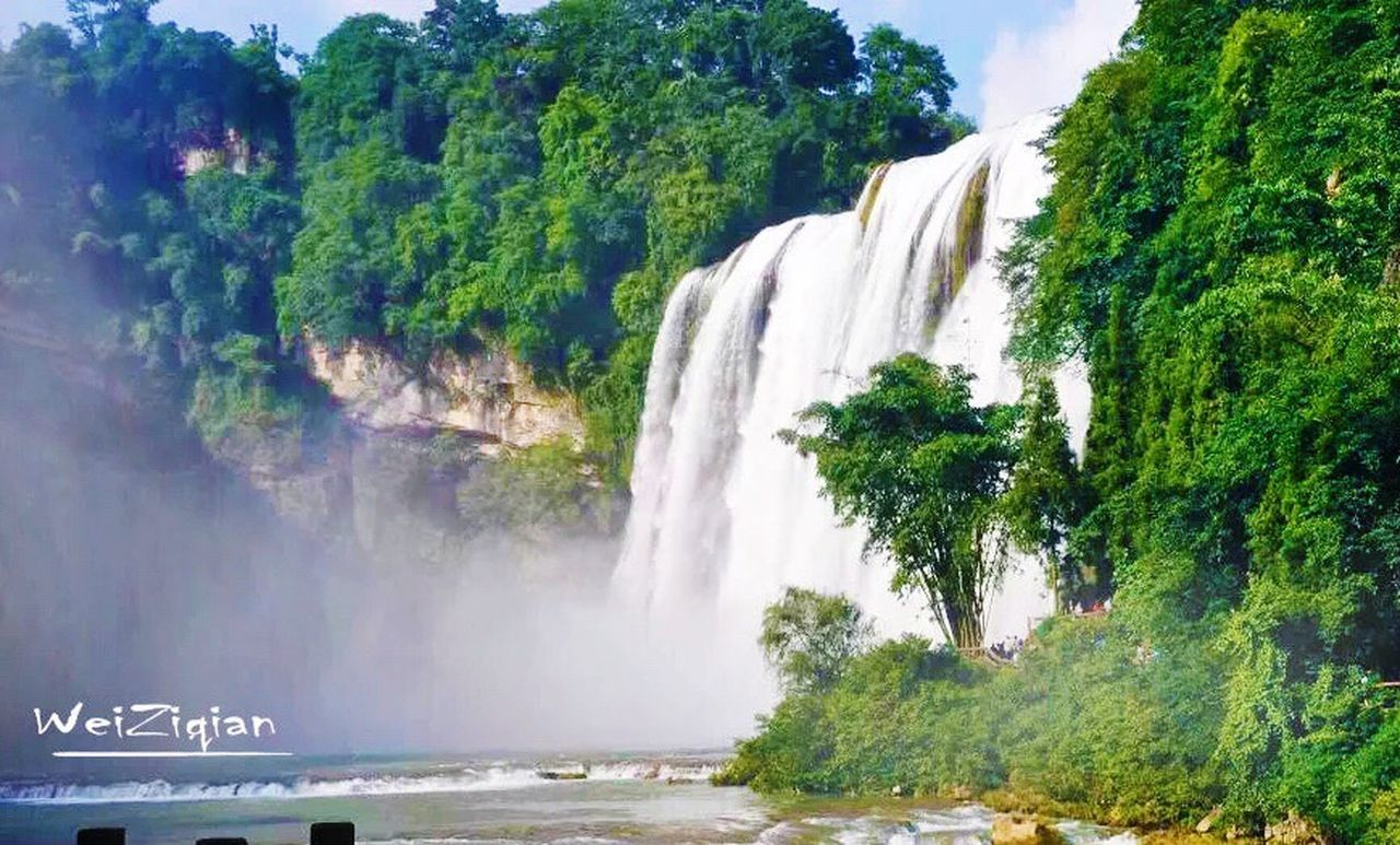 waterfall in China Waterfall Water Scenics Nature Tree Cliff Travel Beauty In Nature Travel Destinations Outdoors Tourism Idyllic Flowing No People Motion Vacations Day Power In Nature Sky