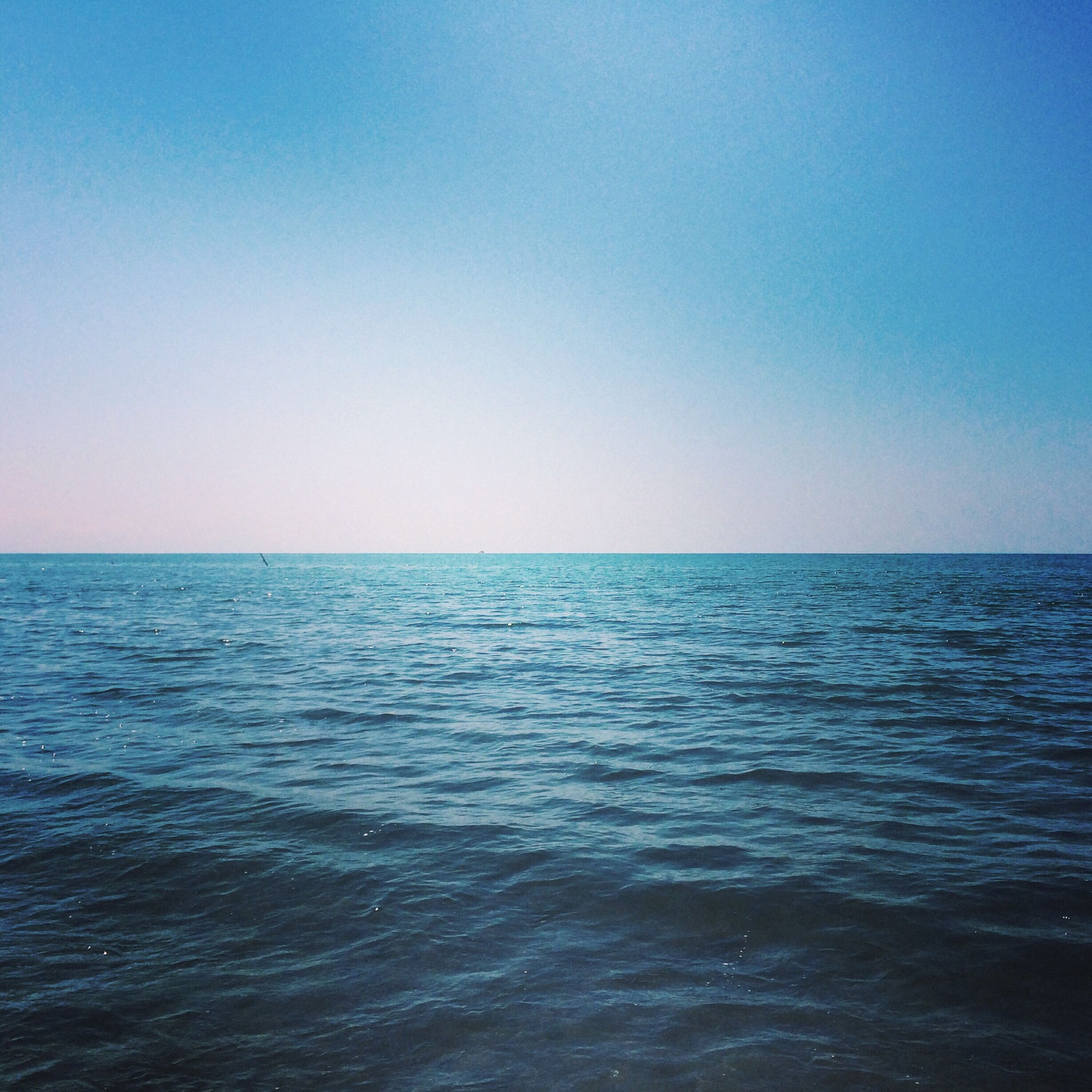 water, sea, clear sky, horizon over water, copy space, tranquil scene, blue, scenics, tranquility, beauty in nature, waterfront, rippled, nature, seascape, idyllic, calm, remote, outdoors, day, no people