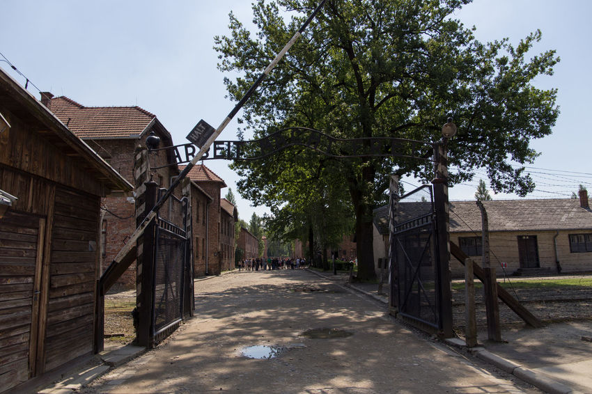 Aushwitz Crakow Eastern Europe Entrance Gate Poland Architecture Aushwitz Camp Building Exterior Built Structure Day Krakow Nature No People Outdoors Sky Tree Wood - Material