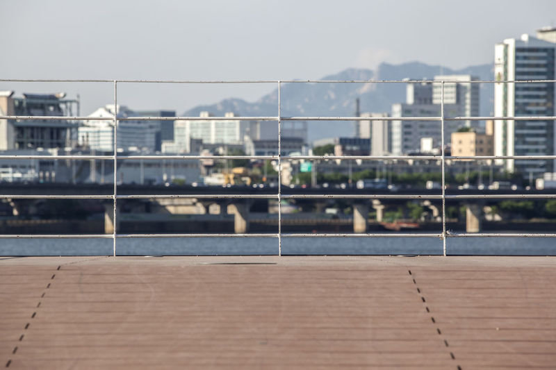 Architecture Beauty In Nature Building Built Structure City City Life Day Fence Fences Focus On Foreground Han River Han River Park Nature No People Outdoors Riverside Sky Travel Destinations Water Weather